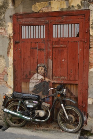 A boy and an old motorcycle