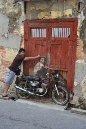 Street art - A boy and an old motorcycle
